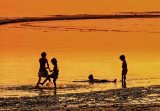 kids playing on beach in koh samui