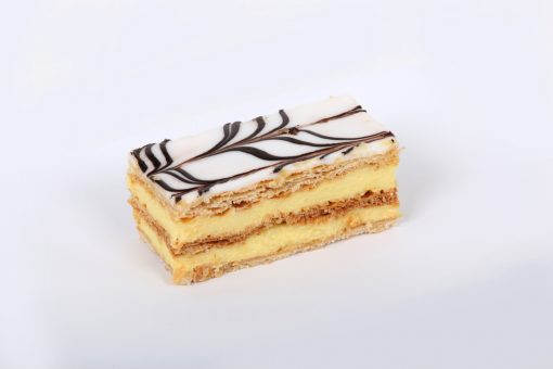 Vanilla slice (also known as mille-feuille) is made up of three layers of puff pastry with two layers of pastry cream separating the puff pastry.