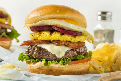 Think of a normal burger, and then fill it with pineapple, pickled beetroot, onion, cheese, bacon, and even a fried egg. Welcome to the Aussie burger with the lot.