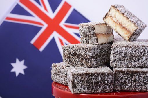 Australian cake is made from butter or sponge cake, then coated in chocolate sauce, and rolled in coconut.